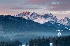 Alpenglow, Wetterstein mountains in winter. Alpenglow over Wetterstein mountains, Bavaria, Germany, with Zugspitze in winter Royalty Free Stock Photography