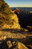 Alpenglow paints the cliffs and ridges Stock Image