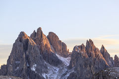 Alpenglow at the peaks. Mountain peaks in alpenglow in dolomites Stock Photography