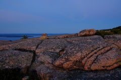 Alpenglow at sunset makes the Pink Granite rocks and crevasses o Royalty Free Stock Image