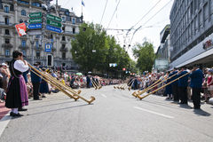 Alpenhorn band. Group of alphorn players exhibiting themselves in the streets of Luzern, Switzerland. A folkloristic event called Jodlerfest which took place on Stock Image