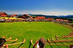 Alpenhorn blåsare Arkivbilder
