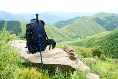 Alpenstock and backpack Stock Photo