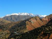 Alpes lointaines de neige Photos libres de droits