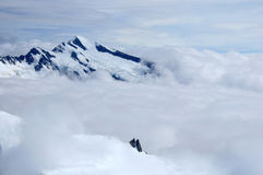 Alpes nuageuses Photographie stock