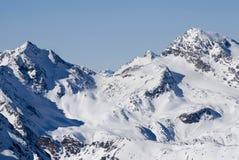 alpes skidar vinter Arkivfoto
