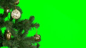 Alpha Channel transparent background. Mans hand hangs a golden ball on a Christmas tree branch. Preparation for the. A man`s hand hangs a golden ball on a stock video