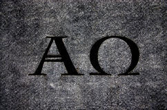 Alpha- en Omega in steen Stock Foto's
