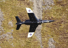 Alpha jet. The Alpha jet is a lightweight attack and training jet.  Here it passes meters from a mountain wall as it practices at low level flying.  May 7th 2013 Royalty Free Stock Photography