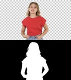 Emotional happy and positive beautiful young woman talking and walking with hands in pockets, Alpha Channel stock image