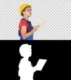 Female construction engineer looking at tablet and checking object, Alpha Channel royalty free stock image