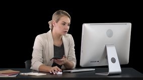 Woman Using Mobile Phone At Desk, Alpha Channel. On Alpha Matte. Woman Using Mobile Phone At Desk, Alpha Channel Professional shot in 4K resolution. 007. You can stock video