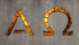 Alpha and Omega Signs. In glass Royalty Free Stock Photography
