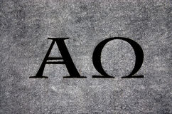 Alpha and Omega in stone stock photo