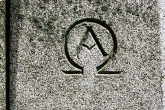 Alpha Omega Symbol Carved en piedra Imágenes de archivo libres de regalías