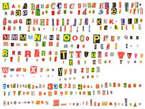 Alphabet. Newspaper uppercase, lowercase, numbers and symbols cutouts isolated on white. Mix and match to make your own words royalty free stock photo