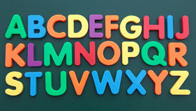 Alphabet. The alphabet in multicolored bold letters on a blackboard Royalty Free Stock Image