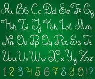 Alphabet. Hand drawn alphabet on a green chalkboard Stock Photos