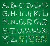 Alphabet. Hand drawn alphabet on a green chalkboard Stock Photography