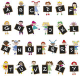 Alphabet. Illustration of children with letters of aphabet on blackboard Royalty Free Stock Image
