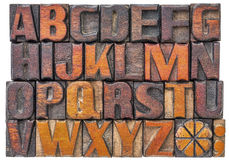 Alphabet abstract in wood type. Alphabet abstract in antique letterpress wood type printing blocks isolated on white Stock Photos