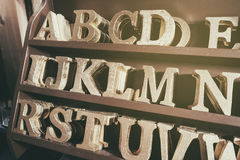 Alphabet Art and Craft supply display on shelf Royalty Free Stock Image
