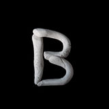 Alphabet B mold by clay on brown wooden Stock Images