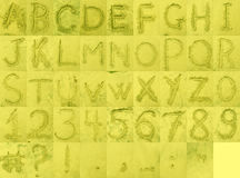 Alphabet on Beach Sand. English letters and characters drawings  on wet beach sand Royalty Free Stock Image