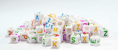 Alphabet beads. Block letters on a white background Stock Images