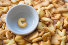 Alphabet biscuit in ceramic cups letters C. Alphabet biscuit in ceramic cups Closeup letters C, random letters Stock Photos