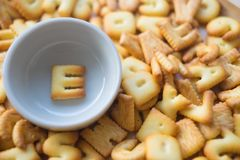 Alphabet biscuit in ceramic cups letters E. Alphabet biscuit in ceramic cups Closeup letters E, random letters Stock Photos