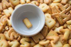 Alphabet biscuit in ceramic cups letters I. Alphabet biscuit in ceramic cups Closeup letters I, random letters Stock Photography