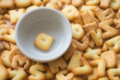 Alphabet biscuit in ceramic cups letters Q. Alphabet biscuit in ceramic cups Closeup letters Q, random letters Stock Image