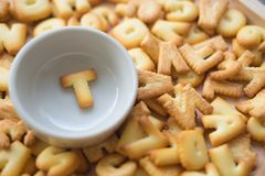 Alphabet biscuit in ceramic cups letters T. Alphabet biscuit in ceramic cups Closeup letters T, random letters Royalty Free Stock Image