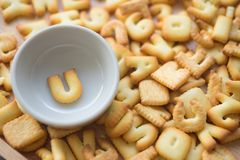 Alphabet biscuit in ceramic cups letters U. Alphabet biscuit in ceramic cups Closeup letters U, random letters Royalty Free Stock Images