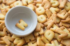 Alphabet biscuit in ceramic cups letters W. Alphabet biscuit in ceramic cups Closeup letters W, random letters Royalty Free Stock Photography