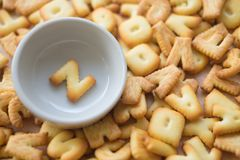 Alphabet biscuit in ceramic cups letters Z. Alphabet biscuit in ceramic cups Closeup letters Z, random letters Royalty Free Stock Photos