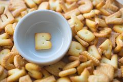 Alphabet biscuit in ceramic cups letters B. Alphabet biscuit in ceramic cups Closeup letters B, random letters Stock Photography