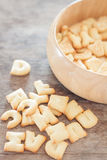 Alphabet biscuit in wooden tray Stock Photos