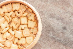 Alphabet biscuit in wooden tray Stock Photo