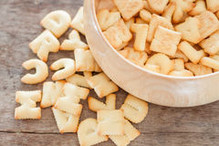 Alphabet biscuit in wooden tray Royalty Free Stock Photo