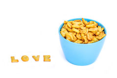 Alphabet Biscuits , word LOVE and blue bowl.  royalty free stock image