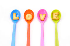 Alphabet Biscuits , word  LOVE  in colorful spoons. Royalty Free Stock Photos