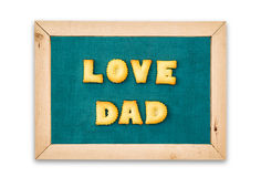 Alphabet Biscuits ,word  LOVE DAD  on chalkboard background. Royalty Free Stock Photography