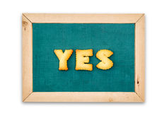 Alphabet Biscuits ,word  YES  on chalkboard background. Royalty Free Stock Photo