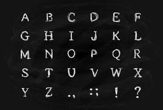 Alphabet on black chalkboard Royalty Free Stock Image