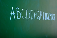 Alphabet on a blackboard Royalty Free Stock Photos
