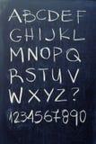 Alphabet on blackboard. English alphabet - white chalk handwriting on blackboard Royalty Free Stock Photography