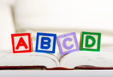 Alphabet block with ABCD on book. Close up Stock Images