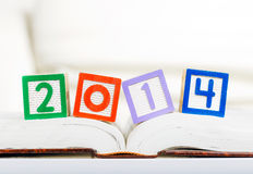 Alphabet block with 2014 on book Royalty Free Stock Photo